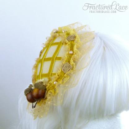 Acorn Pie Fascinator - golden yellow and cream on a circular base