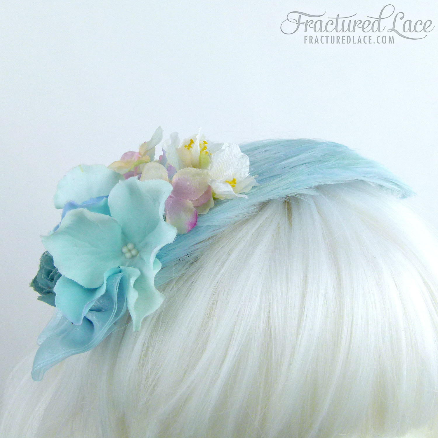 Limited Edition: Delicate light blue fascinator with hydrangea and cherry blossom on a feathered base